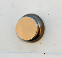 A magnet over a lock can keep bugs and dirt out.