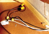 Electrical tape is added to ensure twist-on wire connectors stay connected.