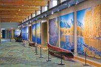 Museum visitors enter galleries off the Hall of Canoes.