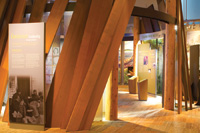 Cedar planks ring an exhibit showcasing the work of the Tulalip Tribes today.