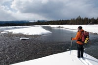 Author Donna Ikenberry's husband, Mike Vining, skis near the Snake River.