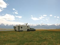 Outfitted with a mobile satellite and solar panels, this RV is home and office.