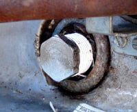 Use a socket wrench to remove and install the anode rod.