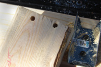 Both the stringer and the fence clip are drilled through to allow bolts to hold the stringer in place.