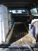 Using hangers rather than another spreader at the tailgate end allows easier access to the truck bed interior.