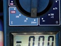The digital voltmeter is set for millivolts.
