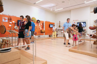 Museum visitors can see musical instruments and hear their sound.