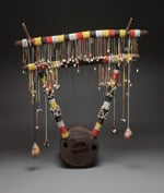 Musical instruments include this tom tom lyre from Sudan.