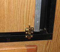 A simple barrel bolt latch solves a problem.