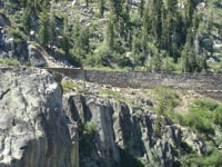 Railroad tracks are built into a cliff east of Donner Pass.