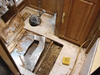 Cutting the old floor away, reveals the floor duct.