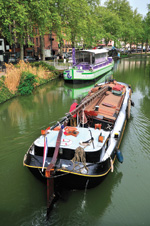A barge on the canal in Toulouse sells items made with violets.