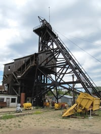 A head frame remains at the closed Orphan Girl Mine.