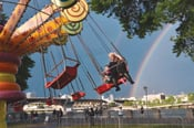 Carnival rides attract visitors to the Portland Rose Festival's City Fair.