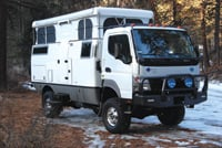 The EarthCruiser is a self-contained vehicle designed for travel over rugged terrain.