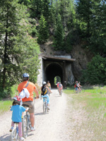 Riders head into one of several tunnels on the trail.