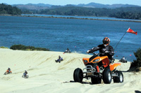A freshwater lake is a backdrop to this section of the Oregon dunes.