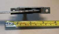 Measure both arm length and distance between mounting hole centers.