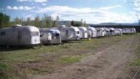 Old Airstreams await restoration at a field in Utah.