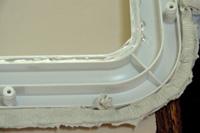 Butyl putty tape on glass perimeter gets sealant.
