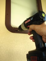 A cordless drill can quickly remove the frame.