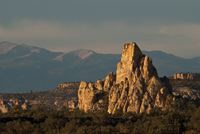 A rock monolith stands in front of Mount Taylor at El Malpais National Monument.