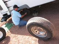 Jim Nelson replaces a bad tire.