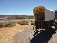 A replica of a covered wagon is featured at the Oregon Trail History and Education Center.