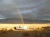 A rainbow can be seen over Nevada's Rye Patch Reservoir.