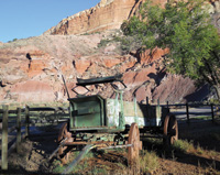 An old wagon is among the remaining farm artifacts.