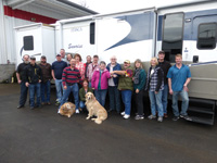 Randy and Bobbie Jennings bought the first RV sold by RV Sales of Oregon and also the 600th. They take the keys to their Itasca Sunrise as they accept delivery from the dealership's owners and employees.