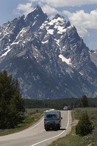 A motorhome travels in the Tetons.