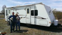 Don and Shelly Hafner, shown with their dogs and travel trailer, have begun a tour of all 59 national parks.