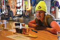 Server Sarah Kester describes the handcrafted brews at the Kettlehouse Brewery in Missoula.