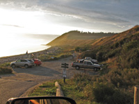 Vehicles park near the water at Ebey's Landing State Park.