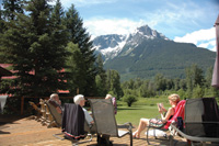 Visitors relax on the deck at the Tweedsmuir Park Lodge.