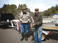 Columnist Bob Ellsberg, left, and his friend Milford claim to be fishing derby champions.