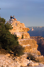 Visitors perch on rocks at Bright Angel Point.