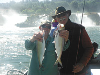 Guide Rob Crandall, left, and Bob Ellsberg hold shad caught on the Willamette River.