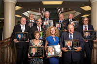 Inductees in the RV/MH Hall of Fame Class of 2013 are, from left, back row, Thomas L. Kern of Style Crest Enterprises; Ed Evans of EPM; Gary McDaniel of Yes! Communities; Richard King of King Insurance; (second row) Barry Cole of Manufactured Housing Insurance Services; Bob Livingston of Good Sam; John D. Roba of Roba and Associates, and (front row) Mrs. James F. Shields accepting for her late husband who owned Pan Pacific RV Centers; Debbie Brunoforte of Little Dealer, Little Prices, and Peter B. Orthwein of Thor Industries.