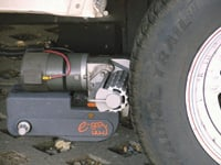 With the cog drive wheel snugged up tight to the trailer tire, the trailer mover is ready to put your trailer where you want it.