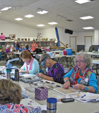 Industrious beaders work on projects at their annual workshop in Arizona.