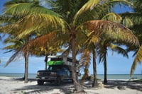 On their way home to Chile, Carola Teixido and Victor Millan parked their truck camper on the beach at San Crisanto, Yucatán, Mexico.