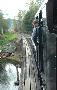 The Mt. Rainier Scenic Railroad train crosses a stream.