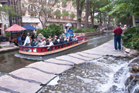 A tour boat takes visitors along San Antonio's River Walk.