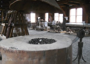 A blacksmith forge in a shop building was used to maintain mining equipment.