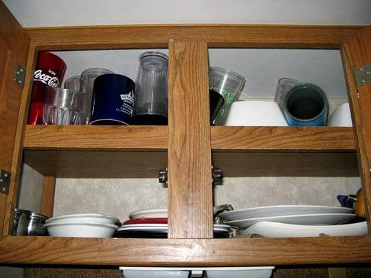 Crowded RV kitchen cupboard