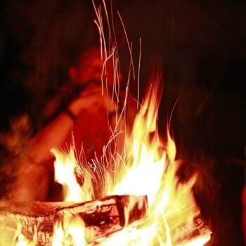 burning trash in campfire