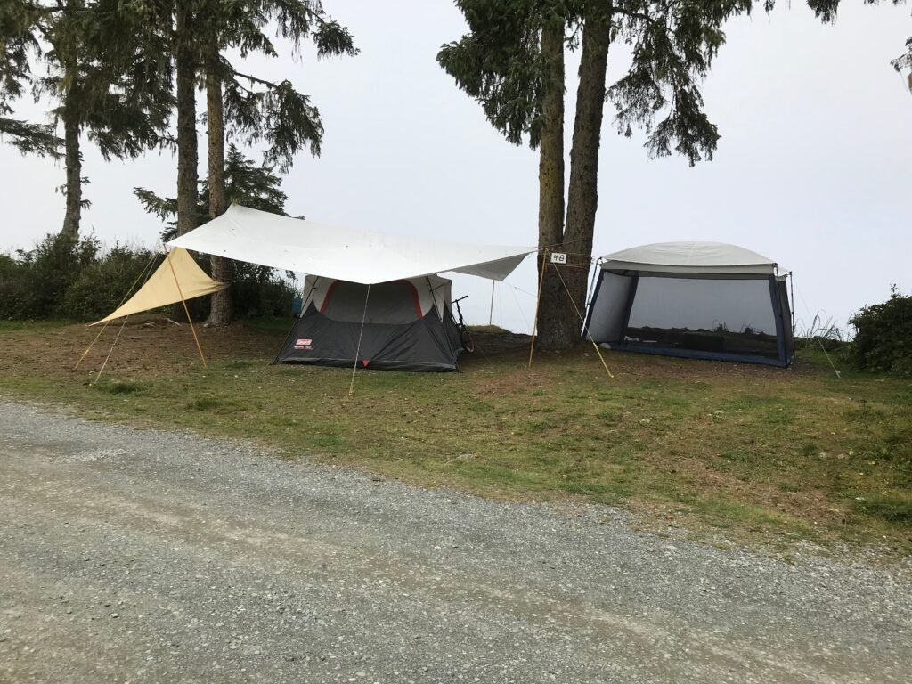 a gray day with campsite protected with tarps