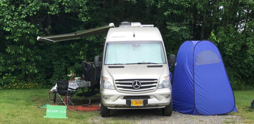 portable shower outside of a camper van